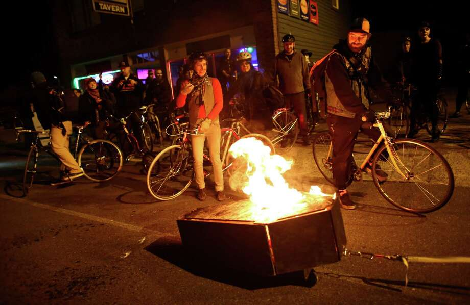 A flaming coffin is towed by a bike through Georgetown during a Day of the Dead funeral march and party. Photo: JOSHUA TRUJILLO, SEATTLEPI.COM / SEATTLEPI.COM