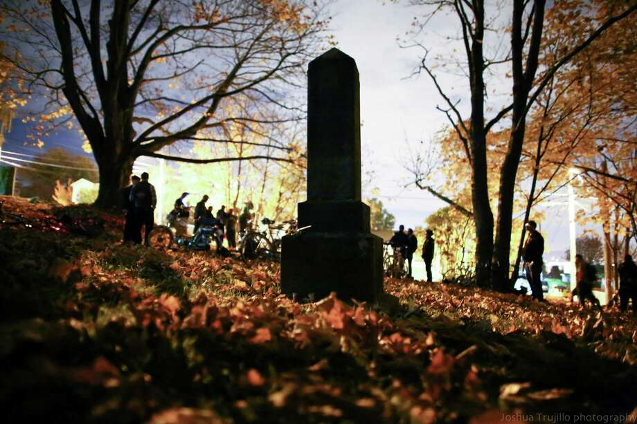 People gather at the Comet Lodge Cemetery before a Day of the Dead funeral march and party. The unique Georgetown event was a twist on a Latin American day that traditionally honors the dead. Photo: JOSHUA TRUJILLO, SEATTLEPI.COM / SEATTLEPI.COM