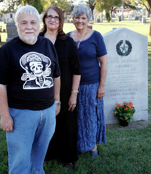 Jose Antonio Navarro's descendants, nephew Gilbert Patino, granddaughter Sandy Salinas and niece Rosemary Geyer, stand by Navarro's grave site on Nov. 1, 2013, at San Fernando Cemetery No. 1. Navarro was one of two native Texans who signed the Texas Declaration of Independence. Photo: Cynthia Esparza, San Antonio Express-News / For the SAN ANTONIO EXPRESS-NEWS