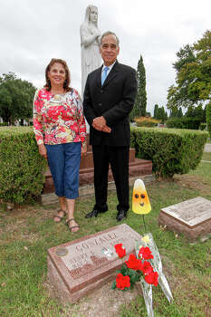 Former Congressman Charlie Gonzalez (right) and his sister, Genevieve Barto, visit the grave of their father, former Congressman Henry B. Gonzalez at San Fernando Cemetery No. 2 on Oct. 30, 2013. Photo: MARVIN PFEIFFER, San Antonio Express-News / Express-News 2013
