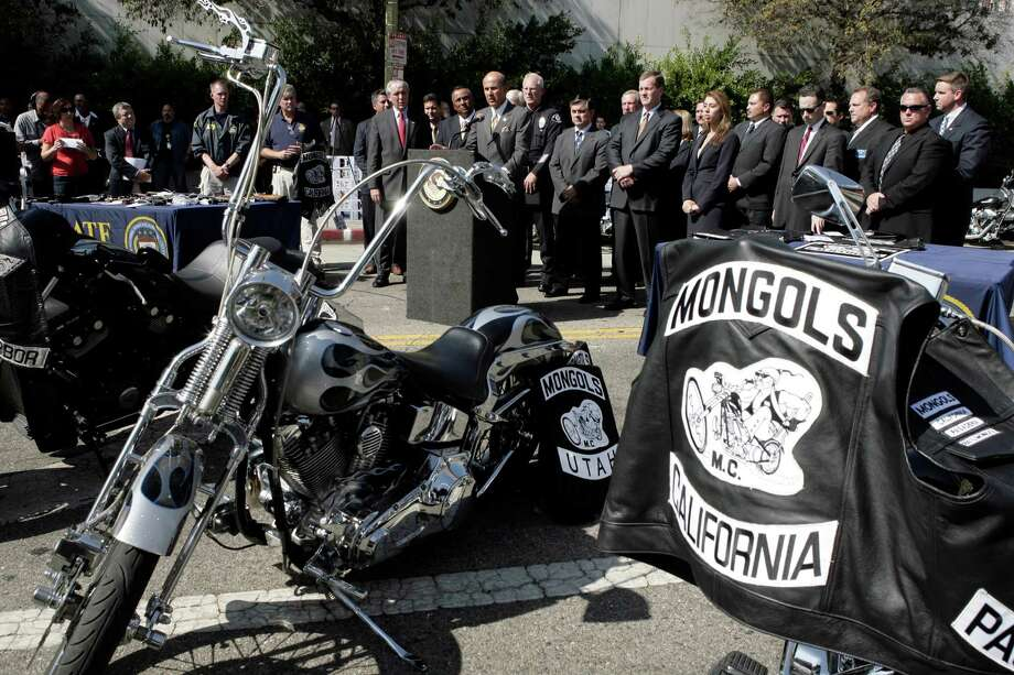 Los Angeles County Sheriff Lee Baca, at podium, speaks during a news conference Tuesday, Oct. 21, 2008, in Los Angeles. Dozens of burly, tattoo-covered Mongol motorcycle gang members were arrested Tuesday by federal agents in six states, including Washington, on warrants ranging from drug sales to murder after a three-year undercover investigation in which four agents successfully infiltrated the group. Photo: Ric Francis, . / AP2008