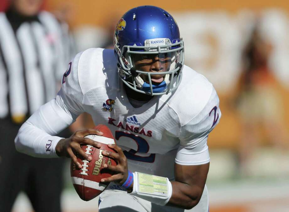Kansas' Montell Cozart looks to pass against Texas during the first half of an NCAA college football game, Saturday, Nov. 2, 2013, in Austin, Texas. (AP Photo/Eric Gay) Photo: Eric Gay, Associated Press / AP