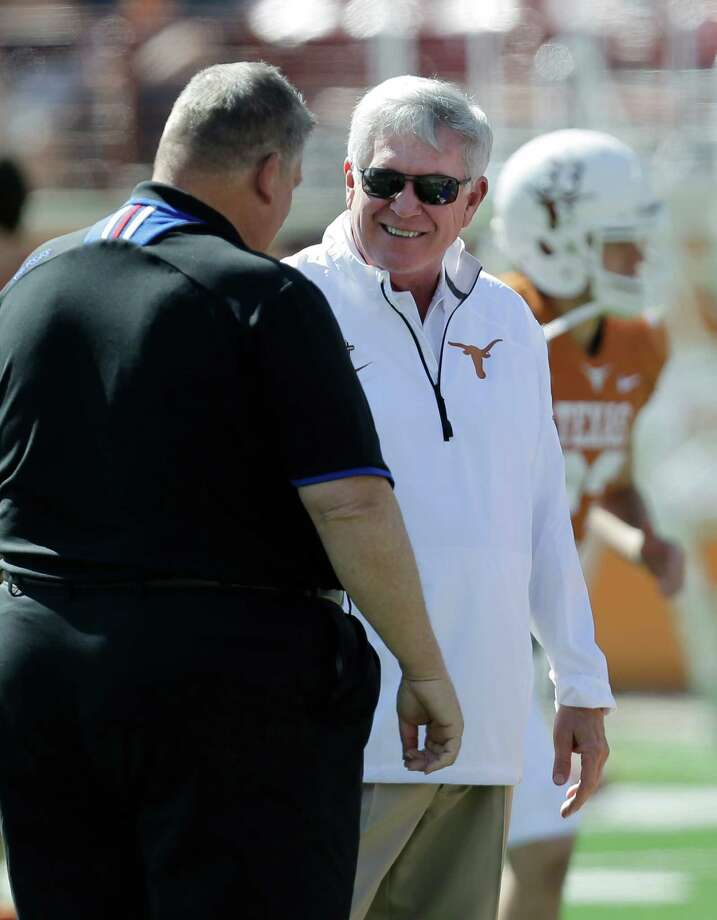 Kansas coach Charlie Weis, left, and Texas coach Mack Brown prior to their NCAA college football game, Saturday, Nov. 2, 2013, in Austin, Texas. (AP Photo/Eric Gay) Photo: Eric Gay, Associated Press / AP
