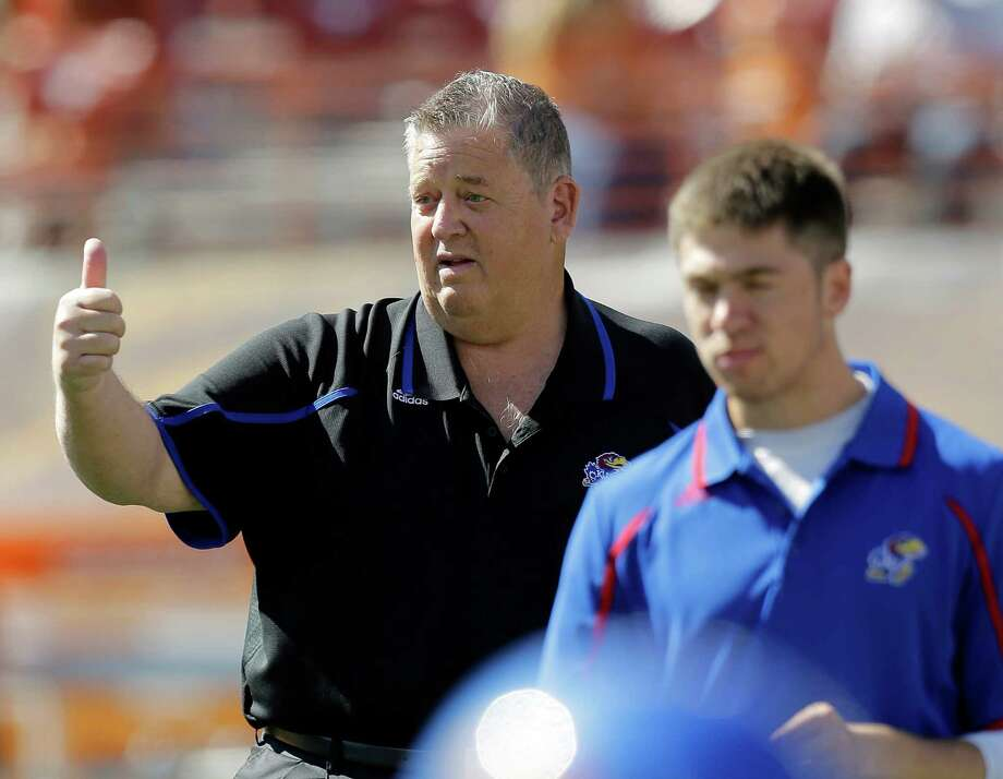 Kansas coach Charlie Weis, left, prior to an NCAA college football game against Texas, Saturday, Nov. 2, 2013, in Austin, Texas. (AP Photo/Eric Gay) Photo: Eric Gay, Associated Press / AP
