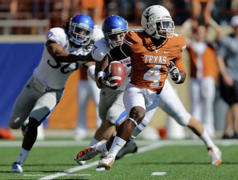 Texas' Daje Johnson (4) returns a kickoff against Texas during the first half of an NCAA college football game, Saturday, Nov. 2, 2013, in Austin, Texas. (AP Photo/Eric Gay) Photo: Eric Gay, Associated Press / AP