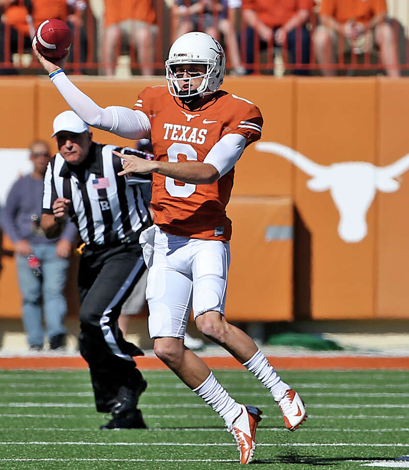 Case McCoy throws on the run as Texas hosts Kansas at Darrell K. Royal Stadium  on November 2, 2013. Photo: TOM REEL, San Antonio Express-News