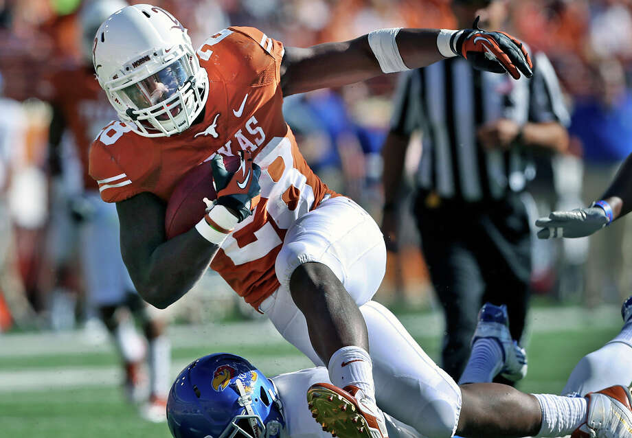 Malcom Brown runs over defenders to get near the end zone as Texas hosts Kansas at Darrell K. Royal Stadium  on November 2, 2013. Photo: TOM REEL, San Antonio Express-News