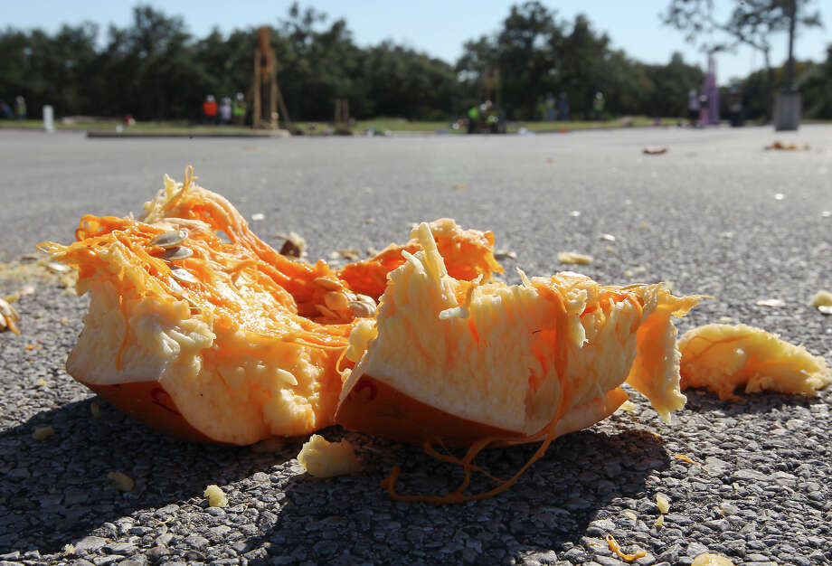 Remnants of a pumpkin are splayed out in a parking lot after it was launched from a trebuchet made by UTSA students for the school's popular Monster Mash Pumpkin Smash in conjunction with STEM Fest on Saturday, Nov. 2, 2013. The event challenged students to design and build a trebuchet or catapult that could best launch an object like a pumpkin. The event was open to the public. Photo: Kin Man Hui, San Antonio Express-News / ©2013 San Antonio Express-News