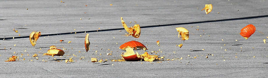 A pumpkin explodes into pieces after it was launched by a trebuchet made by UTSA students during the school's popular Monster Mash Pumpkin Smash in conjunction with STEM Fest on Saturday, Nov. 2, 2013. The event challenged students to design and build a trebuchet or catapult that could best launch an object like a pumpkin. The event was open to the public. Photo: Kin Man Hui, San Antonio Express-News / ©2013 San Antonio Express-News