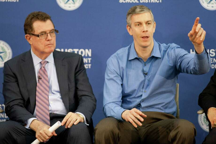 Secretary of Education Arne Duncan, right, makes remarks  while seated next to HISD Superintendent Dr. Terry Grier during a panel discussion at Lee High School Friday, Feb. 15, 2013, in Houston. ( Brett Coomer / Houston Chronicle ) Photo: Brett Coomer, Staff / © 2013 Houston Chronicle