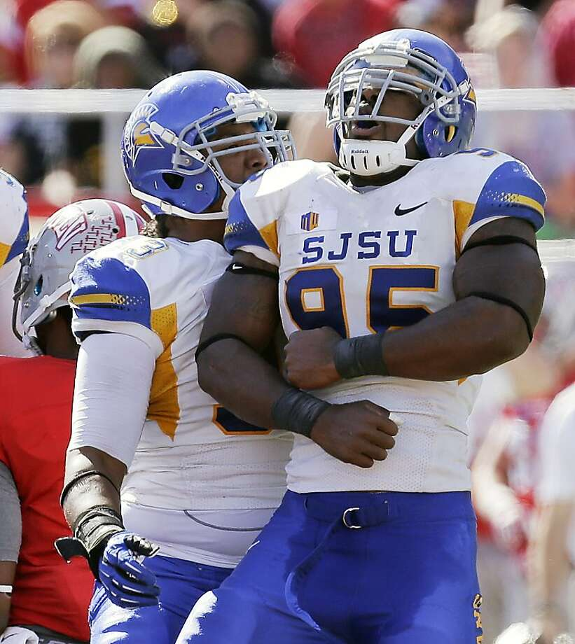 San Jose State's Sean Bacon (95) and Foloi Vae get the party started with a sack in Las Vegas. Photo: Julie Jacobson, Associated Press