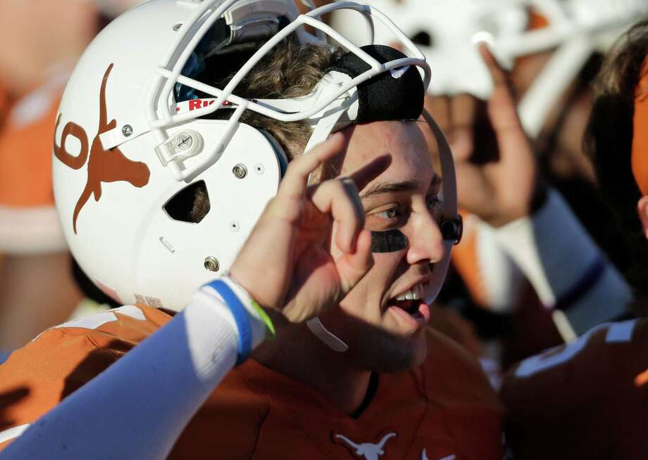 Texas' Case McCoy sings the school song after the team's 35-13 win over Kansas in an NCAA college football game, Saturday, Nov. 2, 2013, in Austin, Texas. (AP Photo/Eric Gay) Photo: Eric Gay, Associated Press / AP