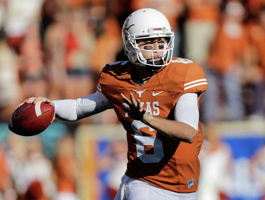 Texas' Case McCoy looks to pass against Kansas during the second half of an NCAA college football game, Saturday, Nov. 2, 2013, in Austin, Texas. Texas won 35-13. (AP Photo/Eric Gay) Photo: Eric Gay, Associated Press / AP