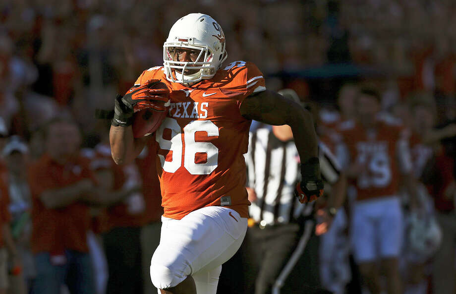 Chris Whaley runs for a touchdown in the second half as Texas hosts Kansas at Darrell K. Royal Stadium  on November 2, 2013. Photo: TOM REEL, San Antonio Express-News