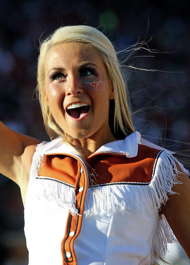 Cheerleaders celebrate a touchdown as Texas hosts Kansas at Darrell K. Royal Stadium  on November 2, 2013. Photo: TOM REEL, San Antonio Express-News