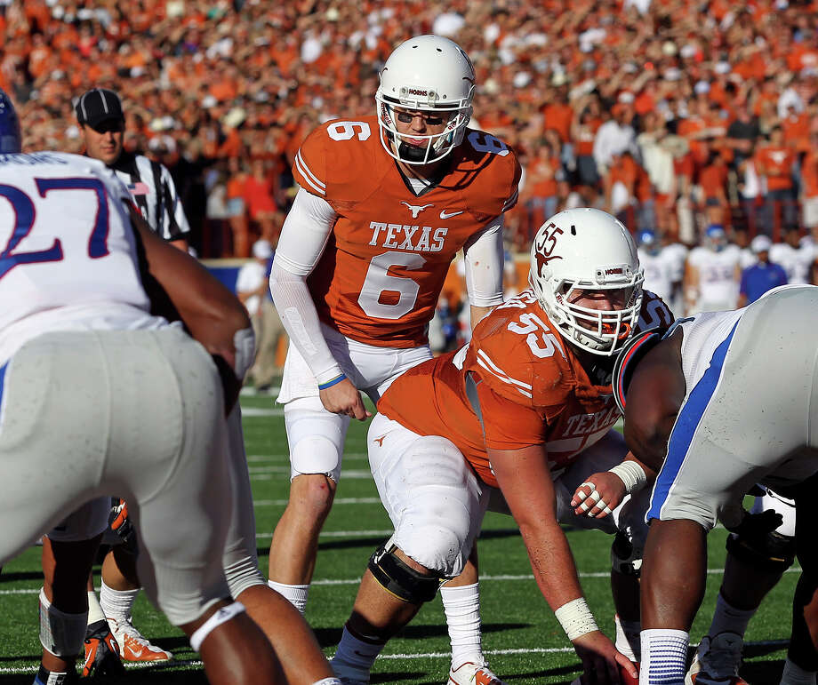 Case McCoy runs the offense near the goal as Texas hosts Kansas at Darrell K. Royal Stadium  on November 2, 2013. Photo: TOM REEL, San Antonio Express-News