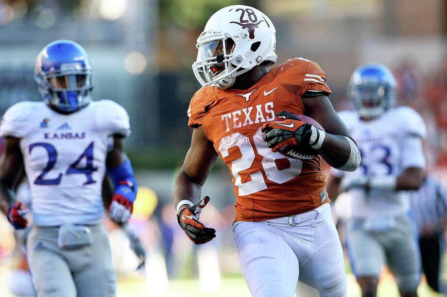 Malcolm Brown speeds to a touchdown as Texas hosts Kansas at Darrell K. Royal Stadium  on November 2, 2013. Photo: TOM REEL, San Antonio Express-News