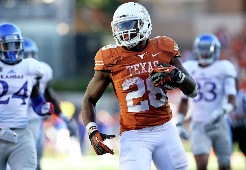 Malcolm Brown speeds to a touchdown as Texas hosts Kansas at Darrell K. Royal Stadium on November 2, 2013.