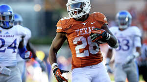 Malcolm Brown speeds to a touchdown as Texas hosts Kansas at Darrell K. Royal Stadium  on November 2, 2013.