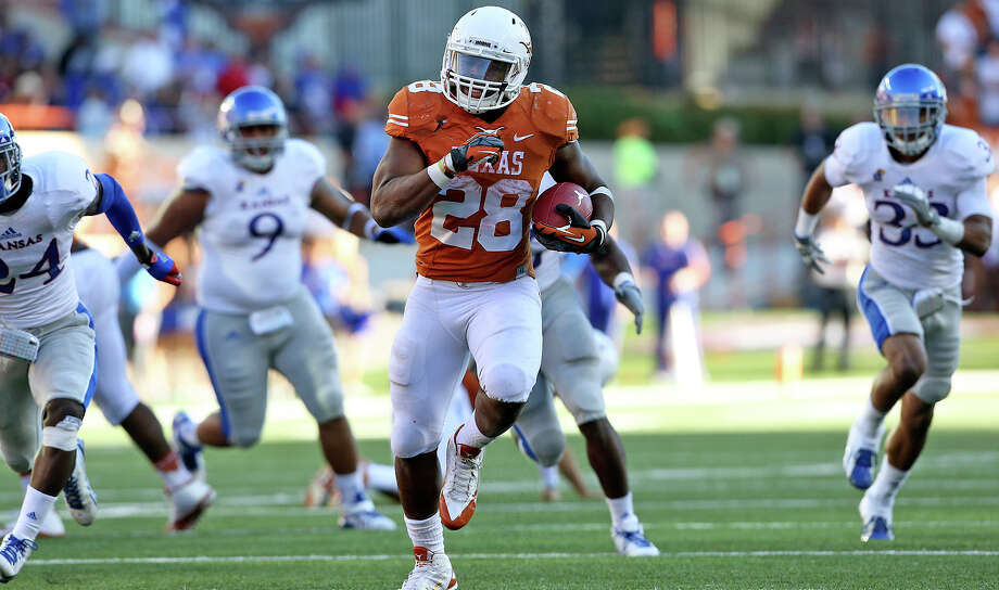 Malcolm Brown speeds to a touchdown as Texas hosts Kansas at Darrell K. Royal Stadium  on November 2, 2013. Photo: TOM REEL, San Antonio Express-News
