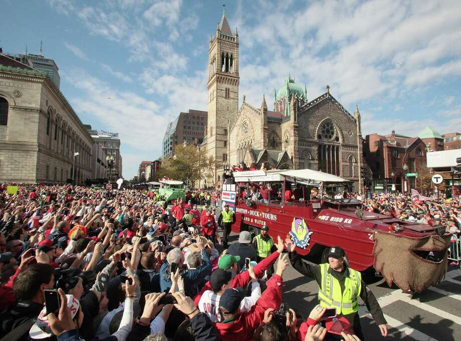 BOSTON, MA - NOVEMBER 2:  Duck boats make their way down Boylston Street where fans gathered for the  World Series victory parade for the Boston Red Sox on November 2, 2013 in Boston, Massachusetts. Photo: Gail Oskin, Getty Images / Getty Images