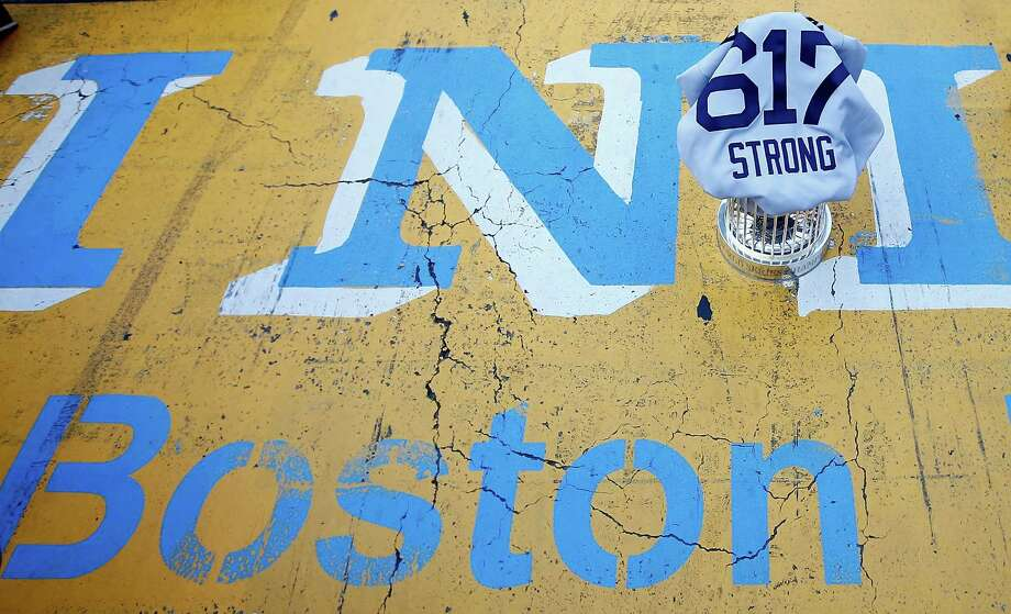 BOSTON, MA - NOVEMBER 02:  The World Series trophy and the 'Boston Strong 617' jersey sit on the finish line of the Boston Marathon on Boylston Street during the World Series victory parade on November 2, 2013 in Boston, Massachusetts. Photo: Jared Wickerham, Getty Images / Getty Images