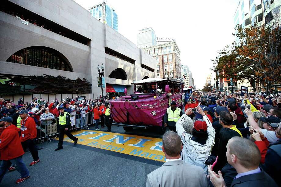 BOSTON, MA - NOVEMBER 02:  A duck boat carrying members of the Boston Red Sox drives across the finish line of the Boston Marathon on Boylston Street during the World Series victory parade on November 2, 2013 in Boston, Massachusetts. Photo: Jared Wickerham, Getty Images / Getty Images