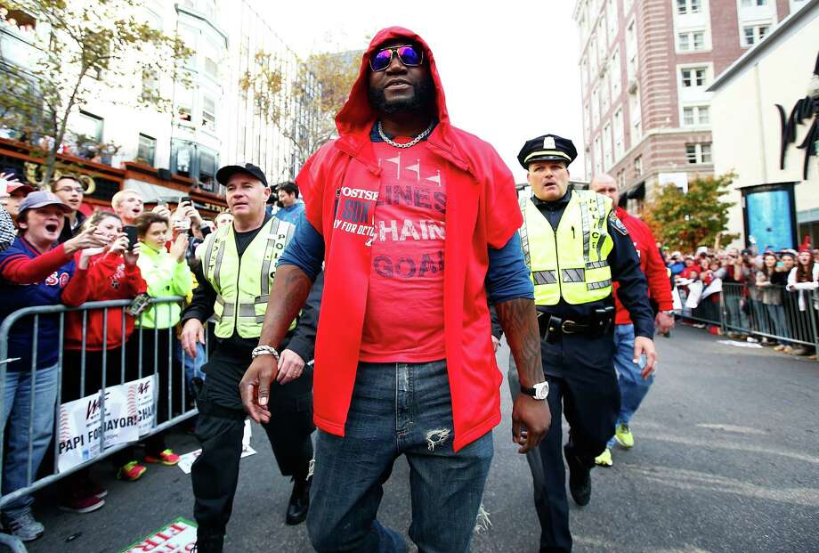 BOSTON, MA - NOVEMBER 02: David Ortiz #34 of the Boston Red Sox walks down Boylston Street near the finish line of the Boston Marathon during the World Series victory parade on November 2, 2013 in Boston, Massachusetts. Photo: Jared Wickerham, Getty Images / Getty Images