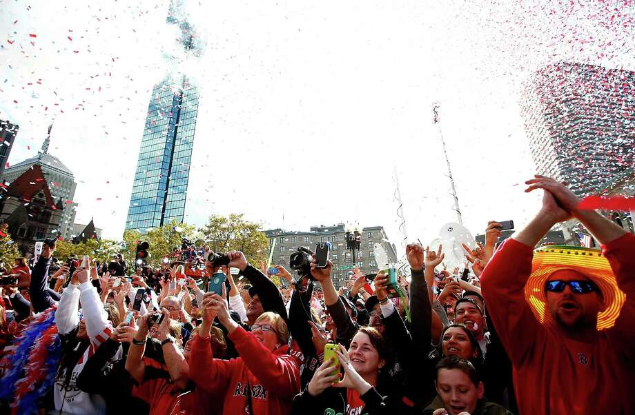 BOSTON, MA - NOVEMBER 02: Boston Red Sox fans cheer on Boylston Street during the World Series victory parade on November 2, 2013 in Boston, Massachusetts. Photo: Jared Wickerham, Getty Images / Getty Images