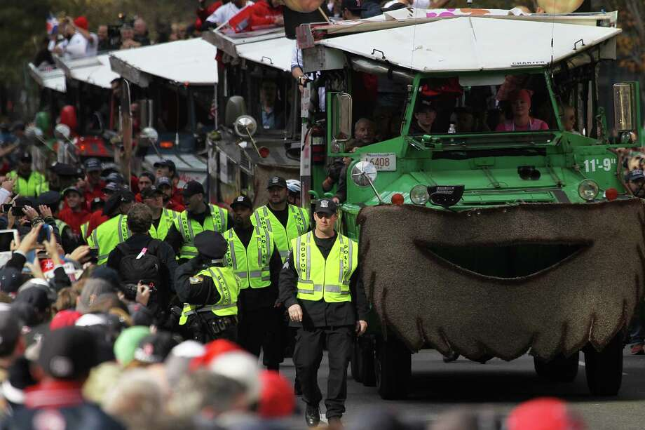 BOSTON, MA - NOVEMBER 2:  Police escort Duck boats as they made their way down Boylston Street where fans gathered for the  World Series victory parade for the Boston Red Sox on November 2, 2013 in Boston, Massachusetts. Photo: Gail Oskin, Getty Images / Getty Images