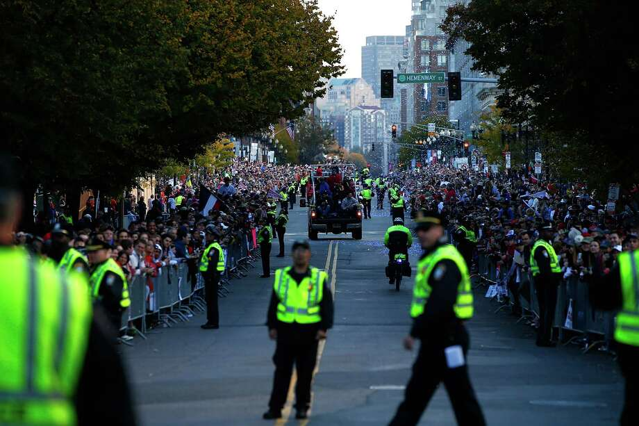 BOSTON, MA - NOVEMBER 02: Members of the Boston Police Department prepare for the floats carrying members of the Boston Red Sox to travel down Boylston Street during the World Series victory parade on November 2, 2013 in Boston, Massachusetts. Photo: Jared Wickerham, Getty Images / Getty Images