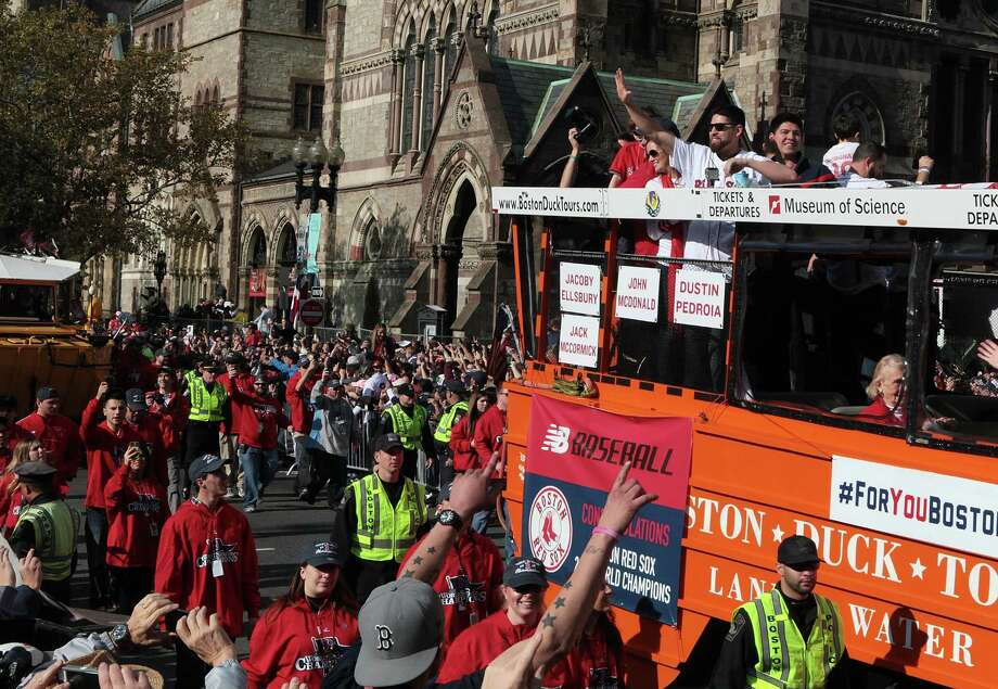 BOSTON, MA - NOVEMBER 2:  Jacoby Ellsbury (R) of the Boston Red Sox waves from one of the duck boats as they make their way down Boylston Street where fans gathered for the World Series victory parade for the Boston Red Sox on November 2, 2013 in Boston, Massachusetts. Photo: Gail Oskin, Getty Images / Getty Images