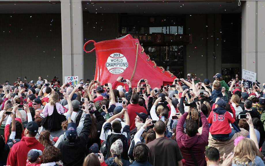 BOSTON, MA - NOVEMBER 2:  Fans gather at Boston City Hall Plaza to watch the World Series victory parade for the Boston Red Sox on November 2, 2013 in Boston, Massachusetts. Photo: Gail Oskin, Getty Images / Getty Images