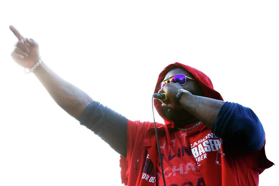 BOSTON, MA - NOVEMBER 02:  David Ortiz #34 of the Boston Red Sox celebrates on a float during the World Series victory parade on November 2, 2013 in Boston, Massachusetts. Photo: Jared Wickerham, Getty Images / Getty Images