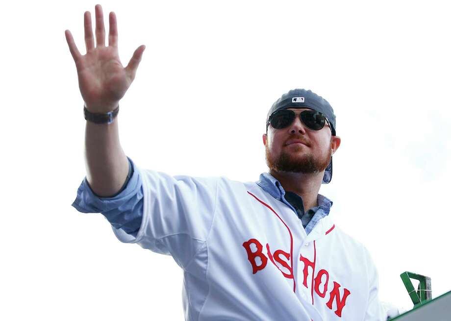 BOSTON, MA - NOVEMBER 02: Jon Lester #31 of the Boston Red Sox waves to the crowd during the World Series victory parade on November 2, 2013 in Boston, Massachusetts. Photo: Jared Wickerham, Getty Images / Getty Images