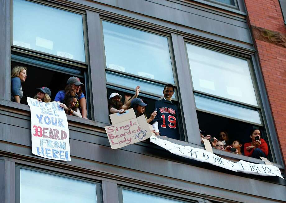 BOSTON, MA - NOVEMBER 02:  Boston Red Sox fans cheer from windows during the World Series victory parade on November 2, 2013 in Boston, Massachusetts. Photo: Jared Wickerham, Getty Images / Getty Images
