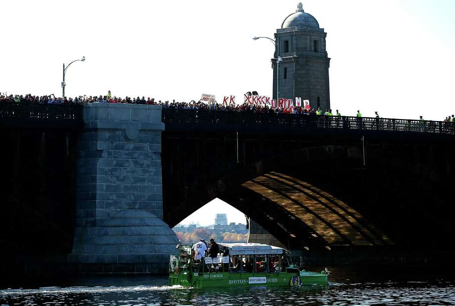 BOSTON, MA - NOVEMBER 02:  Boston Red Sox fans cheer from the Longfellow Bridge as a duck boat carrying Jon Lester #31 of the Boston Red Sox passes by during the World Series victory parade on November 2, 2013 in Boston, Massachusetts. Photo: Jared Wickerham, Getty Images / Getty Images