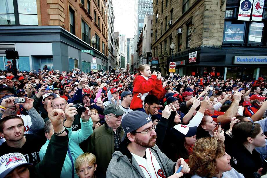 BOSTON, MA - NOVEMBER 02:  Boston Red Sox fans cheer during the World Series victory parade on November 2, 2013 in Boston, Massachusetts. Photo: Jared Wickerham, Getty Images / Getty Images