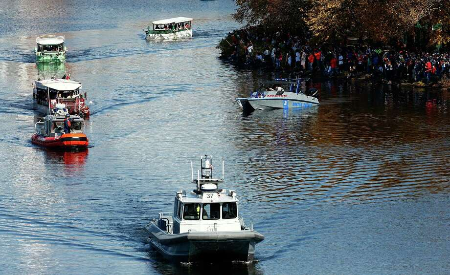 BOSTON, MA - NOVEMBER 02: Ducky boats carrying members of the Boston Red Sox make their way down the Charles River during the World Series victory parade on November 2, 2013 in Boston, Massachusetts. Photo: Jared Wickerham, Getty Images / Getty Images
