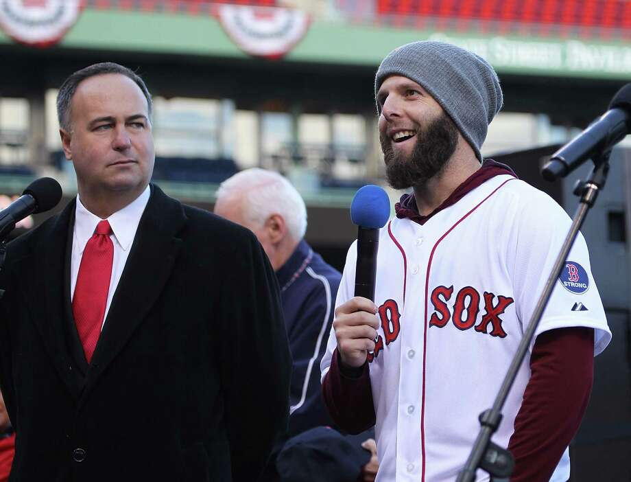 BOSTON, MA - NOVEMBER 2:  Dustin Pedroia addresses the crowd as Don Orsillo looks on before the Red Sox players board the duck boats for the World Series victory parade for the Boston Red Sox on November 2, 2013 in Boston, Massachusetts. Photo: Gail Oskin, Getty Images / Getty Images