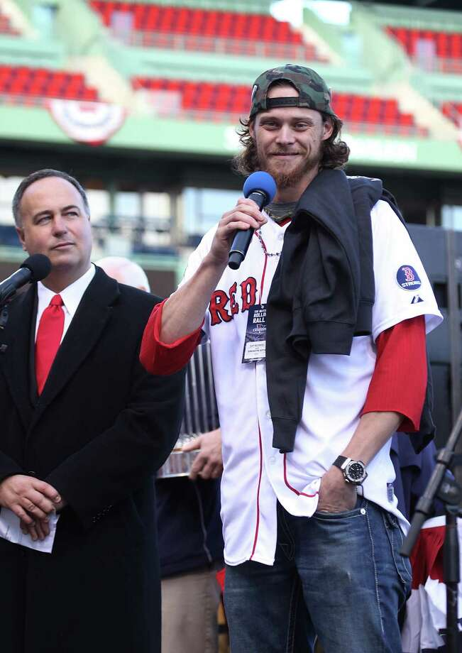 BOSTON, MA - NOVEMBER 2:  Red Sox pitcher Clay Buchholz addresses the crowd at Fenway Park as Don Orsillo looks on before boarding the duck boats for the Boston Red Sox victory parade on November 2, 2013 in Boston, Massachusetts. Photo: Gail Oskin, Getty Images / Getty Images