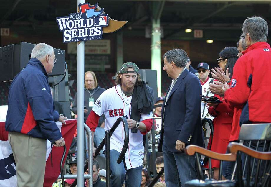 BOSTON, MA - NOVEMBER 2:  Red Sox pitcher Clay Buchholz runs up to the stage to address the crowd at Fenway Park before boarding the duck boats for the Boston Red Sox victory parade on November 2, 2013 in Boston, Massachusetts. Photo: Gail Oskin, Getty Images / Getty Images