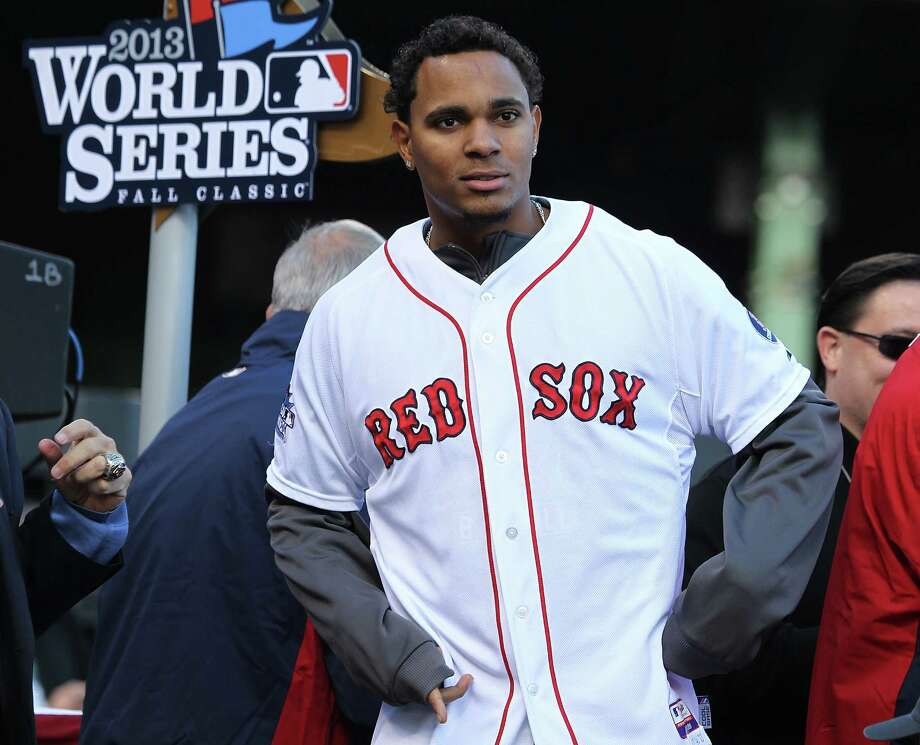 BOSTON, MA - NOVEMBER 2:  Xander Bogaerts addresses the crowd on stage at Fenway Park before the Red Sox players board the duck boats for the World Series victory parade for the Boston Red Sox on November 2, 2013 in Boston, Massachusetts. Photo: Gail Oskin, Getty Images / Getty Images