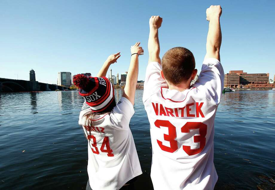 BOSTON, MA - NOVEMBER 02: Fans cheer from the shore of the Charles Rivers during the World Series victory parade on November 2, 2013 in Boston, Massachusetts. Photo: Jared Wickerham, Getty Images / Getty Images