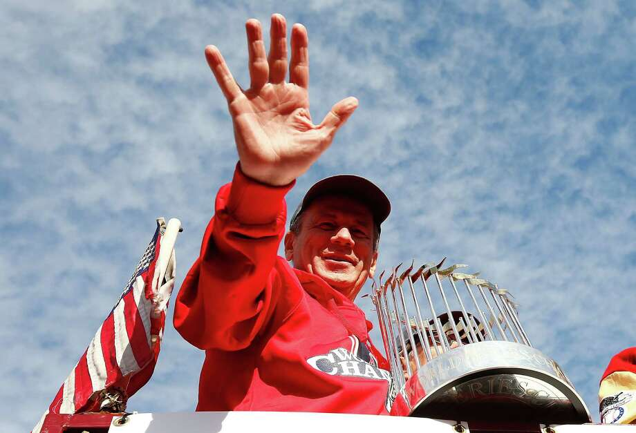 BOSTON, MA - NOVEMBER 02: President and Chief Exective Officer Larry Lucchino of the Boston Red Sox holds up the World Series trophy during the World Series victory parade on November 2, 2013 in Boston, Massachusetts. Photo: Jared Wickerham, Getty Images / Getty Images
