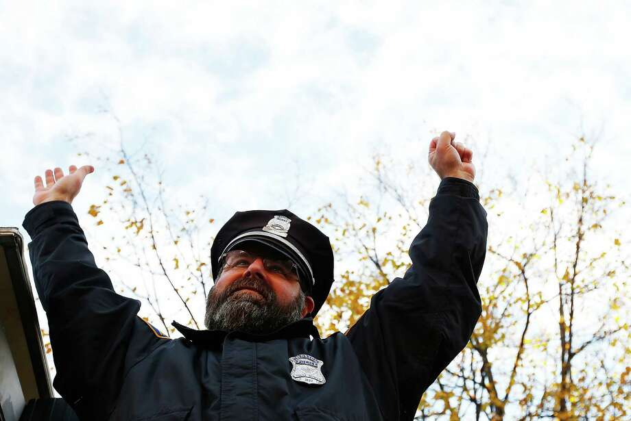 BOSTON, MA - NOVEMBER 02: Boston Police officer, Steve Horgan, raises his arms during the World Series victory parade on November 2, 2013 in Boston, Massachusetts. Photo: Jared Wickerham, Getty Images / Getty Images