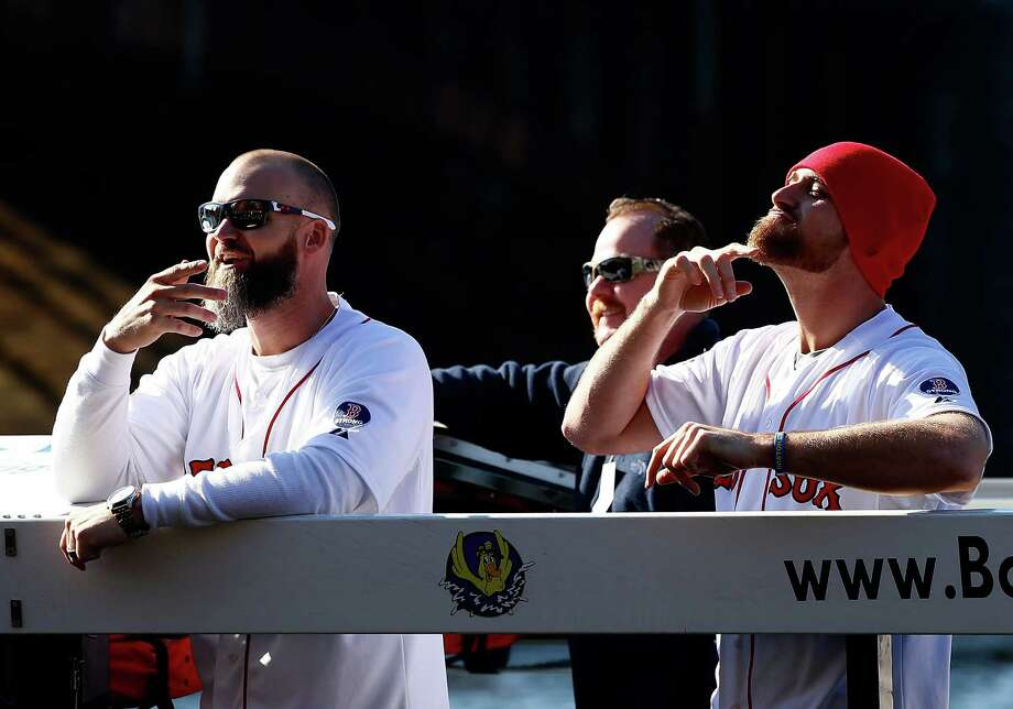 BOSTON, MA - NOVEMBER 02: David Ross #3 and Will Middlebrooks #16 of the Boston Red Sox celebrate on the Charles River during the World Series victory parade on November 2, 2013 in Boston, Massachusetts. Photo: Jared Wickerham, Getty Images / Getty Images