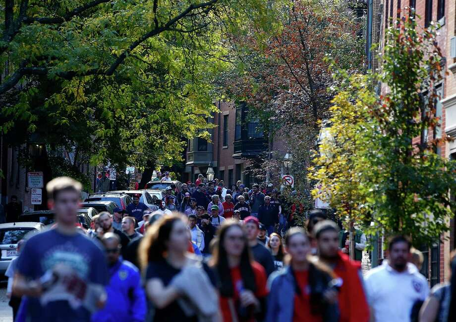 BOSTON, MA - NOVEMBER 02: Fans make their way down side streets in the Back Bay section of Boston during the World Series victory parade on November 2, 2013 in Boston, Massachusetts. Photo: Jared Wickerham, Getty Images / Getty Images