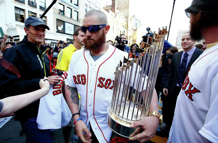 BOSTON, MA - NOVEMBER 02:  Jonny Gomes #5 carries the World Series trophy near the finish line of the Boston Marathon on Boylston Street during the World Series victory parade on November 2, 2013 in Boston, Massachusetts. Photo: Jared Wickerham, Getty Images / Getty Images
