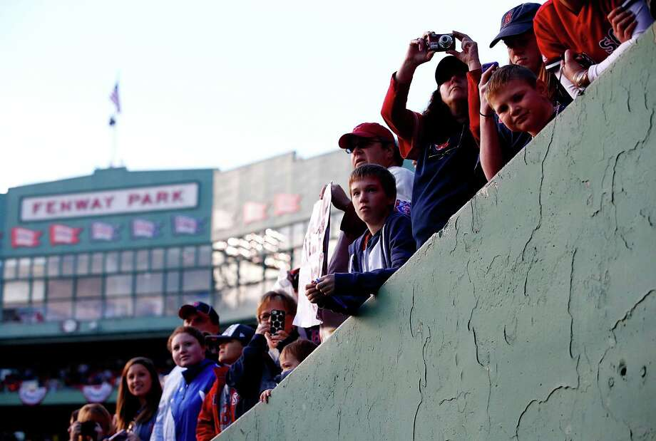 BOSTON, MA - NOVEMBER 02: Fans look on during the World Series victory parade at Fenway Park on November 2, 2013 in Boston, Massachusetts. Photo: Jared Wickerham, Getty Images / Getty Images